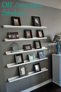DIY Living Room Shelving (for Picture Frames) Five shelves built for under $60! I don't like 5 of them because I think it is too much BUT i think 3 would be cute