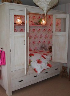 Child's bed in a cabinet. Cute!