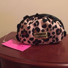 NWT Betsey Johnson Ruffle Leopard Cosmetic Case Brand new with tags! Super cute little cosmetic make-up case. Gold tone hardware, zip top closure lined with black ruffle. Classic gold Betsey heart zipper pull. Tan leopard print pattern. Classic Betsy black and pink floral print interior. NO TRADES Betsey Johnson Bags Cosmetic Bags & Cases