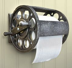 A unique industrial toilet paper holder! This wall-mounted fishing reel toilet paper holder is made of polyresin stone and measures W x H x D. It holds a double or standard roll of toilet paper. Such a wonderful addition t Diy Bathroom, Nautical Bathrooms, Bathroom Toilets, Bathroom Ideas, Bathroom Organization, Bathroom Cabinets, Remodel Bathroom, Lake House Bathroom, Bathroom Storage