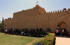 raqi Christians who fled the violence in the village of Qaraqush, about 30 kilometres east of the northern province of Nineveh, rest upon th...