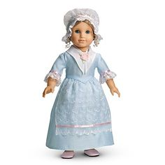Elizabeth's Tea Lesson Gown was introduced to Elizabeth's Collection in 2005 and retired in 2010. It is associated with the movie Felicity: An American Girl Adventure. Retail cost was $32. White fichu with rosette on the front. Closes on front with hook-and-eye clasp.