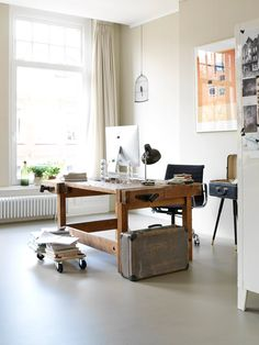 This pretty example of a small urban apartment has a mix of nice details – large windows allowing light to stream in, seamless flooring with an industrial Workspace Inspiration, Interior Inspiration, Office Workspace, Home Office, Küchen Design, House Design, Workbench Table, Urban Apartment, Chesterfield Bank