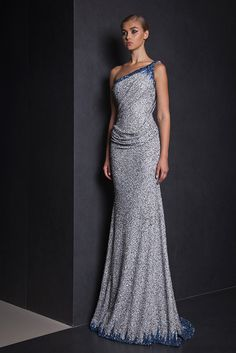 Fully embroidered Light Gray one shoulder draped evening gown in Lace, embellished with delicate Blue embroideries on the neckline and hemline.