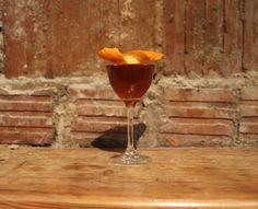 French manhattan  3 oz of Bastille Whiskey 1.5 oz extra dry vermouth 1 dash of Bauchant Orange Liqueur Stir, and strain into martini glass. Garnish with an orange