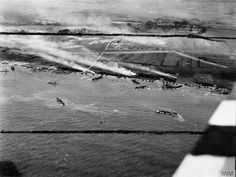Aerial oblique photo of the junction of King Red and King Green beaches, Gold assault area, during the landing of 50th Infantry Division, 6 June 1944. The Mont Fleury battery (WN 35a) and an anti-tank ditch are visible in front of the village of Ver-sur-Mer.