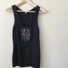 JCrew tank with beading EUC - True to size. This is such a cute one! It's the softest cotton, with (on purpose) raw edging, and the most beautiful beaded embellishment! Great dressed up with a black pencil skirt, or down with some ripped up cut-offs!! J. Crew Tops Tank Tops