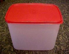 """Tupperware Modular Mates Rectangular #4 Container Red Passion by Tupperware. $28.73. Holds 37 Cups. 9"""" x 8 H. Organize your cabinets with Modular Mates."""