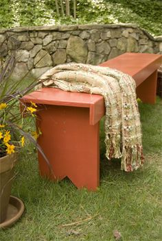 Build a bench DIY from Lowes.  This would also look nice at the end of my bed.
