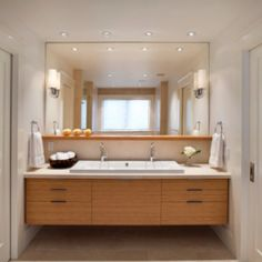 We could do something like this but half the width - recessed lighting, big mirror with shelf.