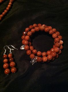 Earrings and memory wire bracelet. I love these beads. So pretty!!