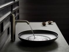 Would love a basin and faucet like this on a natural stone or concrete countertop.  http://www.us.kohler.com/onlinecatalog/suites_collections_details.jsp?imageSize=enlarge&item=15818202&prod_num=Katagami&category=18