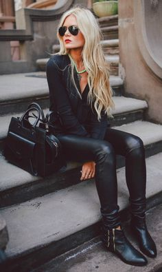 The black outfit at its best. Black shirt, leather pants, ankle boots and bag. Via Amber Fillerup Clark Top/Pants: Helmut, Shoes: ShoeMint, Sunglasses: Ray Ban Bag: Proenza Schouler