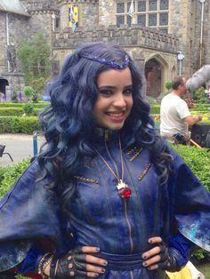 Sofia Carson as Evie