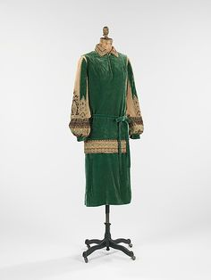 This day dress (c. 1923) displays the influence of regional costume. A folklore look has been a common design inspiration since the nineteenth century. After the 1917 Bolshevik Revolution, Russian émigrés fled to Paris and found work embroidering their traditional designs for fashion houses. Jean Patou and Coco Chanel were two of the designers that helped to promote this new trend, which became popular in both Europe and the US.
