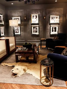 Framed photos of old Hollywood movie stars and historic icons line the Venetian plastered walls in this art deco cigar lounge. An ebony coffee table sits atop the exotic lion rug, while club chairs covered in royal blue velvet finish off the sultry gathering space.