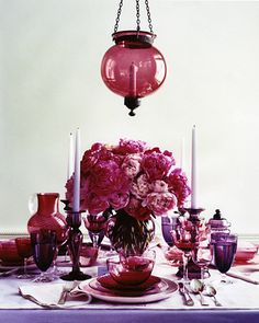 Table Toppers  A hundi shade throws a rosy cranberry glow over mismatched pieces spanning a century of glassmaking. Colored stemware from any period is likely to have clear stems and bases. The small cranberry wineglass (far left) is from the 1880s; the Champagne glass (right of the plate) is circa 1930
