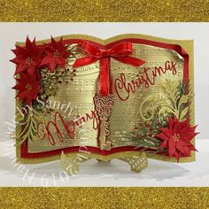 Crafters Companion storybook die set, Christmas Carol embossing folder, poinsettia from the Festive Foliage die set and foliage dies from Winter Wonderland collection. Christmas Card Crafts, Christmas Books, Xmas Cards, Holiday Cards, Christmas Carol, Crafters Companion Christmas Cards, Crafters Companion Gemini, Hobby Lobby Christmas, Shaped Cards
