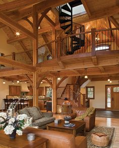 The timber frame defines the spaces in the lower level with posts and beams creating the structure of each room.