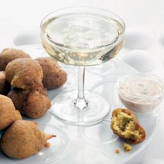 Hush Puppies with Remoulade | Emily Kaiser serves these crispy hush puppies with a version of the creamy French sauce remoulade, which she spikes with Tabasco and a little ketchup.