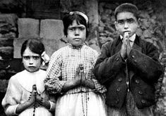 The three F�tima children: Lucia Santos, 10, in the middle; with her cousins, Jacinta, 7, and Francisco Marto, 9.