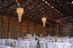Farm Barn Wedding...LOVE the fancy chandeliers with the rustic barn