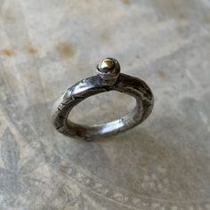 Oxidized sterling silver ring with brass orb.