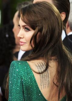Angelina Jolie's beauty evolution - a hint of green shadow to match eyes and dress