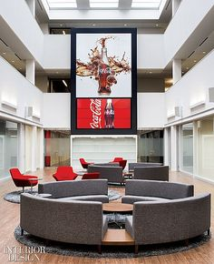 How Sweet It Is: Coca-Cola's Canadian HQ by Figure3 | Sofas by Alison Spear form conversation circles in the central atrium. #design #interiordesign #interiordesignmagazine #office #furniture #architecture