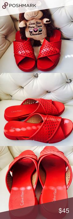 Calvin Klein  red slip on  Beautiful red Calvin Klein slip on made well great color worn once  heavy vinyl material size true 9   Comfortable❤️️❤️️❤️️taking fair offers hit offer button condition only worn once like brand new Calvin Klein Shoes Flats & Loafers