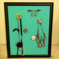Jewelry board. Frame- $8, hooks- $.80 a piece, canvas- $3, paint- $.69.