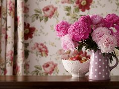 Peony Garden Cranberry from the Laura Ashley wallpaper collection.