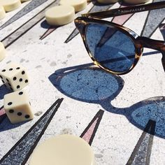 It's finally warm enough to play backgammon outside near our office! We brought our Downing sunglasses along too.