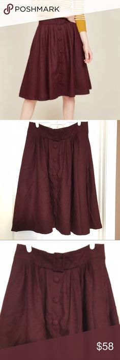 """Intern of Fate Midi Skirt in Burgundy NWOT LARGE Beautiful fall/winter skirt by Modcloth. Never used; bought it last month, took tge tahs off and now when I took it out; it is a bit loose (weight loss). I am re-ordering it in medium because it is so beautiful! It has back zipper, decorative belt (doesn't come off) and it has pockets!! According to Modcloth, size Large is 27"""" long. I measured the waist flat and it is 16"""". Please note it does not provide stretch. Still retails for $69.99 at…"""