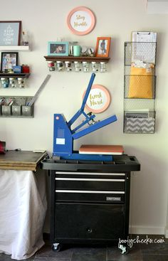 Hey there vinyl using friends! Today I am sharing how I not onlykeep my vinyl organized but where I keep my heat press and how I easily move it around. When I first started using my heat press I had an old table in our garage but in Florida it gets HOT and working in front of a 320 degree press during the Florida summer was miserable and working out there in the winter was often cold! Since hea...