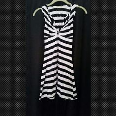 America Rag Dress Sexy, flirty, and makes your cleavage look AMAZING dress. Black and white striped with a racer back. Great dress to wear on a girls night out! Simple, yet sexy! American Rag Dresses Mini