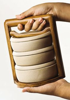 'Rantang' by indonesian designer Jesika Tirtanimala, is a hand-carried lunch box that has separate compartments to keep your meal  from mixing together. The stacked container is held together by an oil-finished teak wood handle.