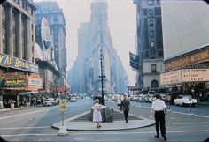 Times Sq NYC 1956 Astor Theatre premiere Robert Aldrich's drama Autumn Leaves with Joan Crawford+Veta Miles+Cliff Robertson and Löewe's State at left premiere Away All Boats(behind is Bond store Pepsi sign+Claridge Hotel)