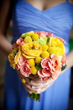 yellow bouquet with ranunculus, billy-balls and roses