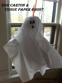 Make an Egg Carton and Tissue Paper Ghost - - This is a super easy Halloween Craft for kids using things you most likely already have in the house.  They're cute too!