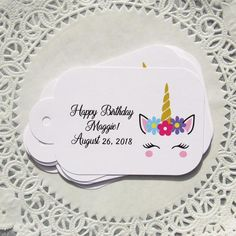 "These adorable unicorn favor tags are sure to be a hit! Our unicorn party favors have a hole punched so you can tie them to what ever you choose . Each favor tag is personalized with the honorees name. If you are throwing a unicorn birthday party these are perfect! Each of our unicorn tags measures 4"" WIDE x 2 1/2"" HIG"