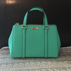 Kate Spade Small Loden Newbury Lane Brightberl Beautiful kate spade small Loden bag in Pristine condition. Has great storage. The Color is called Brightberl.  There's a very light stain at the bottom of the inner non zip pocket, please see pic. Had to use flash and it is still hard to notice. Worn once.  Comes with the original attachable shoulder strap, dust bag, care card and tag (see pic). Original price is $325 + tax. Reasonable offers welcome. kate spade Bags Crossbody Bags