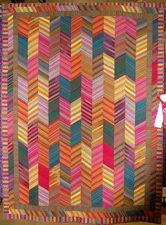 Kaffe Fassett shot cotton stripes quilt by Judy Lockhart. 2011 quilt show photo by YankeeQuilter Quilting Tutorials, Quilting Projects, Quilting Designs, Striped Quilt, Striped Fabrics, Stripe Quilt Pattern, Chevron Quilt, Braid Quilt, Herringbone Quilt