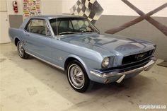 1966 FORD MUSTANG 2 DOOR COUPE. I wish I still had mine. ( Navy blue with baby blue interior).