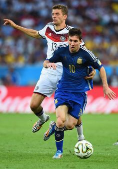 Thomas Mueller of Germany challenges Lionel Messi of Argentina during the 2014 FIFA World Cup Brazil Final match between Germany and Argentina at Maracana on July 13, 2014 in Rio de Janeiro, Brazil.
