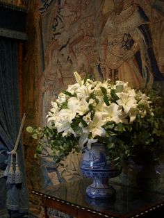 Love the mix of porcelain, flowers and tapestry. So rich and luxurious!