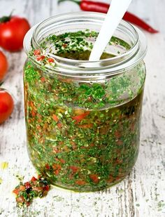 This Argentinian chimichurri with lots of fresh herbs, garlic, peppers and tomatoes tastes wonderful with grilled meats! Chimichurri is een typisch Argentijnse salsa die perfect smaakt bij gegrild vlees, vis en garnalen! Tapenade, Herb Butter, Sauces, Homemade Sauce, Grilled Meat, Mets, Fresh Herbs, Food Inspiration, Hummus