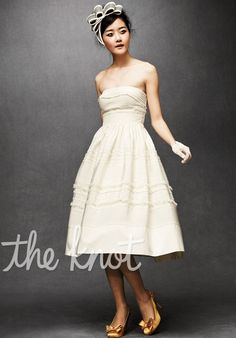 Gown features tufted tulle, rickrack and pintuck embroidery.