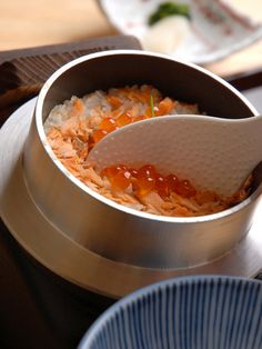 Japanese Kamameshi - rice, meat or fish and vegetables served in a small pot.