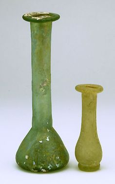 """Two Unguentaria. Roman, 1st to 2nd century AD. Heights: 5-3/8""""; 3"""". $345"""